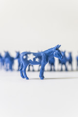United States Democratic Donkey Standing In Front of a Row of Blue Donkeys