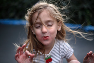 Young Girl Meditating With Her Eyes Closed