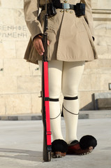 Evzones Greeces historic presidential guard.Tsarouhi is a type of shoe, which is typically known nowadays as part of the traditional uniform worn by the Greek guards known as Evzones