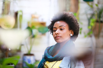 Afro woman looking at something
