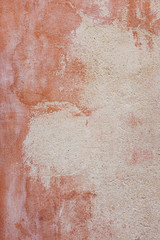 Detail of ochre colored paint on building wall, Provence, France