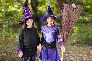 Two little witches with broom