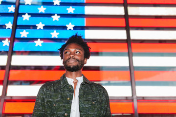 Young Trendy Afro American Man with a Digital USA Flag Backwards in Times Square, New York