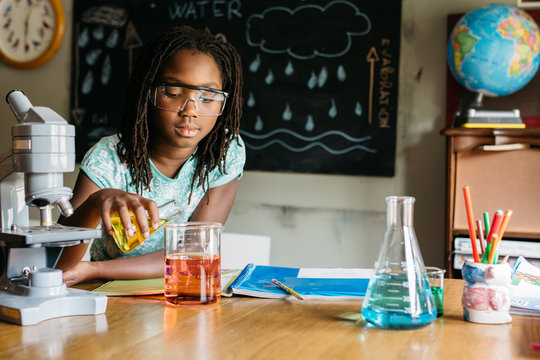 Girl doing a chemistry experiment in science class