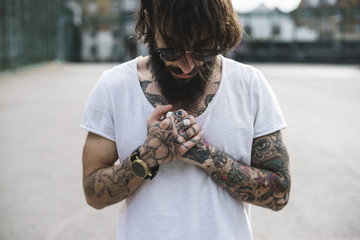 Young tattooed man portrait