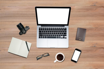 Top view, Flat lay style, Travel set, Working desk, computer, laptop, smart phone, coffee, mug, glasses, notebook and a lot of things on wooden colored background with clipping path.