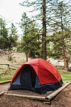 Red camping tent in the forest