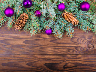 Winter concept of fir-tree on a brown wooden background