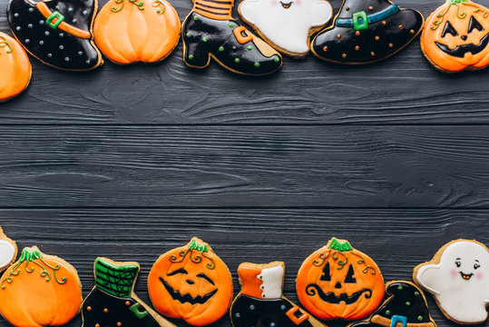 Funny delicious ginger biscuits for Halloween on the table. horizontal view from above