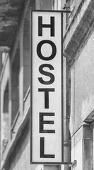 Accommodation,  hostel sign in the city, black and white,