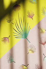 Palm leaf pattern on a pink and yellow diagonal background with shadow