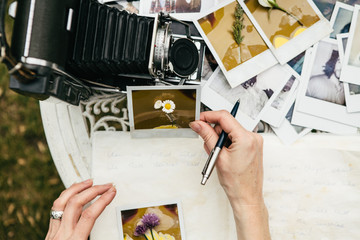 Woman looking at  photos with flowers attached to them