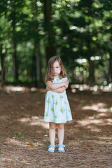 Adorable young girl being grumpy and pouting