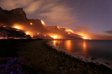 Wildfires burn along the Twelve Apostles area of Table Mountain in Cape Town