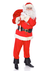 Santa Claus carrying big bag. Isolated on white background. Full length portrait