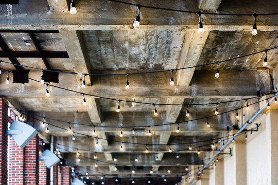 string lights wood ceiling outdoor patio porch
