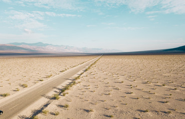 Endless road to the horizon through the Death valley. View from above.