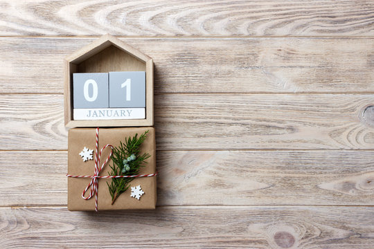 Christmas calendar. Christmas gift, fir branches on wooden white background. Copy space, top view