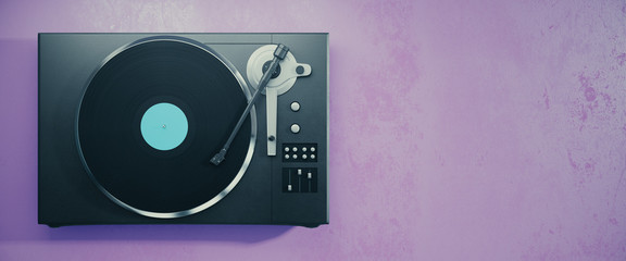 Vinyl record player on purple background