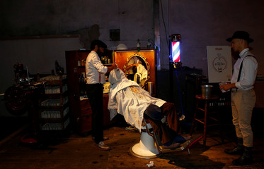 "A guest receives a face massage at the barber corner during "" Swing' n' Milan "" festival in Milan"