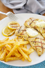 White chicken meat served with french fries