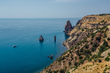 Beautiful view of the mountains and rocky coast of the azure Black sea, Cape Fiolent, Crimea