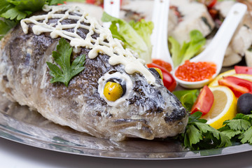 Seabass head with caviar and vegetables