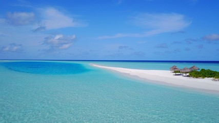 P02369 Aerial flying drone view of Maldives white sandy beach on sunny tropical paradise island with aqua blue sky sea water ocean 4k