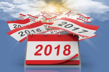 Fogli di calendario ad anelli da scrivania si allontanano verso l'infinito scoprendo l'anno 2018.
