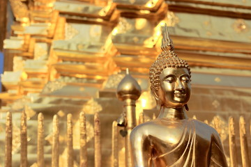 Golden Buddha statue with copy space background.