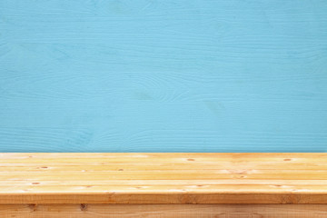 Empty table in front of blue wooden background. For product display montage
