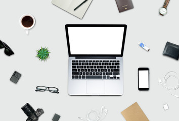 Top view, Flat lay style, Travel set, Working desk, computer, laptop, smart phone, coffee, mug, glasses, notebook and a lot of things on pastel color background with clipping path.