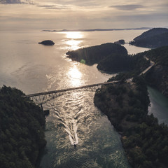 Styilized Coastal Bridge Aerial with Boat in Sunset