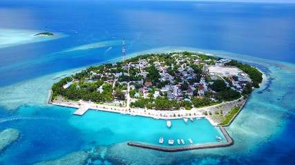 Fotobehang Eiland P02463 Aerial flying drone view of Maldives white sandy beach on sunny tropical paradise island with aqua blue sky sea water ocean 4k