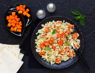 Salad with bulgur and baked pumpkin.