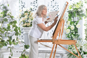 Senior woman drawing picture