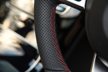 Red stitching on steering wheel