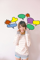 A cute Asian girl with speech bubbles colourful cartoon doodles illustration