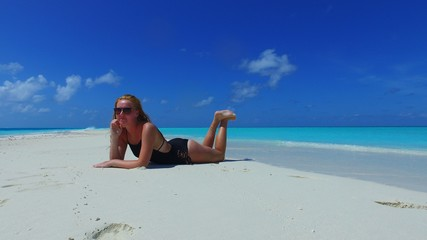 P02711 Maldives white sandy beach 1 person young beautiful woman relaxing on sunny tropical paradise island with aqua blue sky sea water ocean 4k