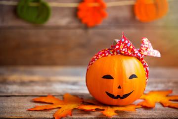 Cute smiling pumpkin wearing red bandana. Close-up