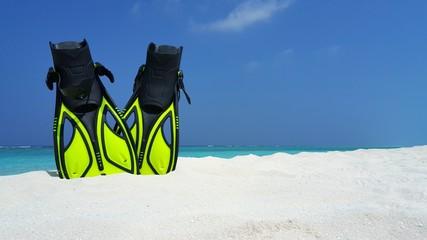 P02993 Maldives white sandy beach fins snorkel mask scuba flippers on sunny tropical paradise island with aqua blue sky sea ocean 4k