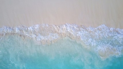 P02198 Aerial flying drone view of Maldives white sandy beach on sunny tropical paradise island with aqua blue sea water ocean 4k