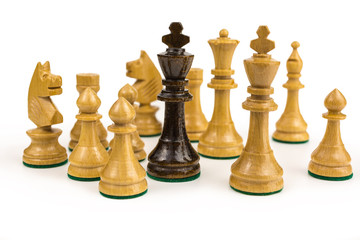 chess king surrounded by opponents