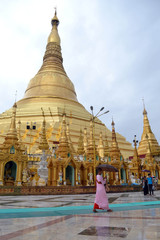 The national religious symbol of Burmese. It's the shwedagon Pagoda with its golden stupa, and many people visiting this place