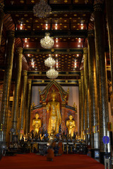 Praying at one temple in Chiang Mai, Thailand. It's a Buddhist ritual