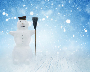 Snowman on winter background