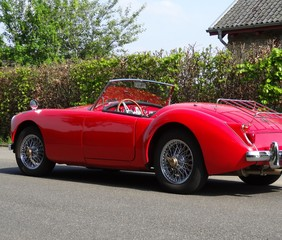 Sports car Oldtimer in red as a convertible