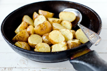 Fried young potatoes in a frying pan