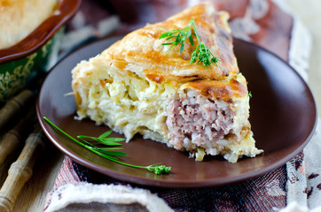 Pie with meat and cheese
