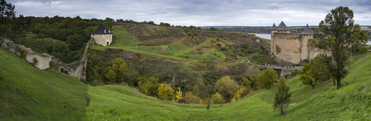 Panorama of old stone fortress with a moat and beautiful nature